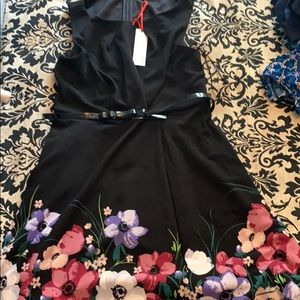 Adorable Dress with Flowered Bottom.